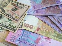 Курс гривни на межбанке в пятницу укрепился до 27,785 грн/$1